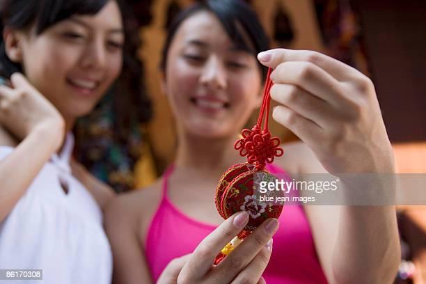 Two young friends shop for souvenirs