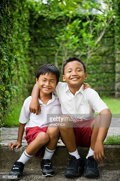 Two young friends with their arms around.