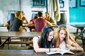 Two young girl studying for exam
