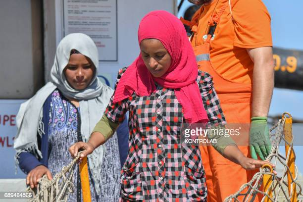 Two young girls during the landing of migrants by Turkish cargo ship Kaptan Hilmi III in port of Corigliano Calabria southern Italy The refugees...