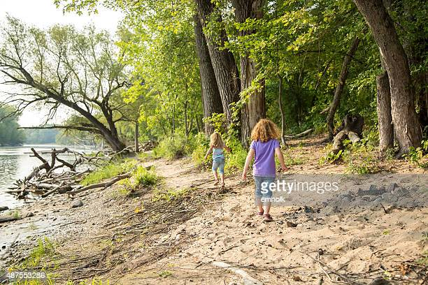 Two Young Girls Exploring Along Bank of Mississippi River