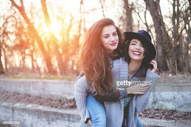 Two young girls having fun in forest