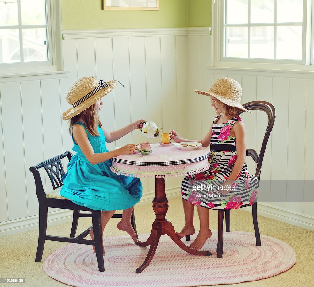 Two young girls having tea party : Stock Photo