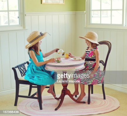 Two young girls having tea party