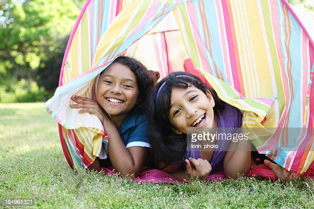 Two young girls in a pastel tent