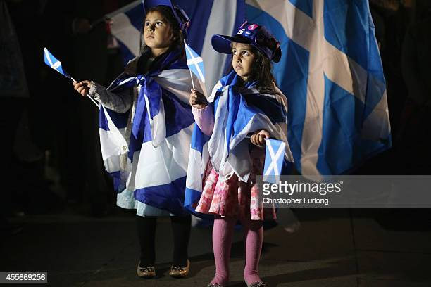 Two young girls join the crowds waiting for a result outside the Scottish Parliament as voting in the referendum continues on September 18 2014 in...