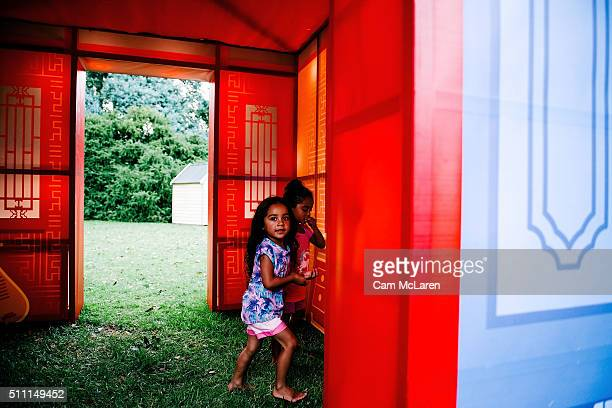 Two young girls play in a display at the Auckland Lantern Festival on February 18 2016 in Auckland New Zealand In it's 17th year and for the first...