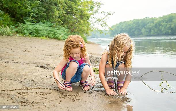 Two Young Girls Playing on Bank of Mississippi River