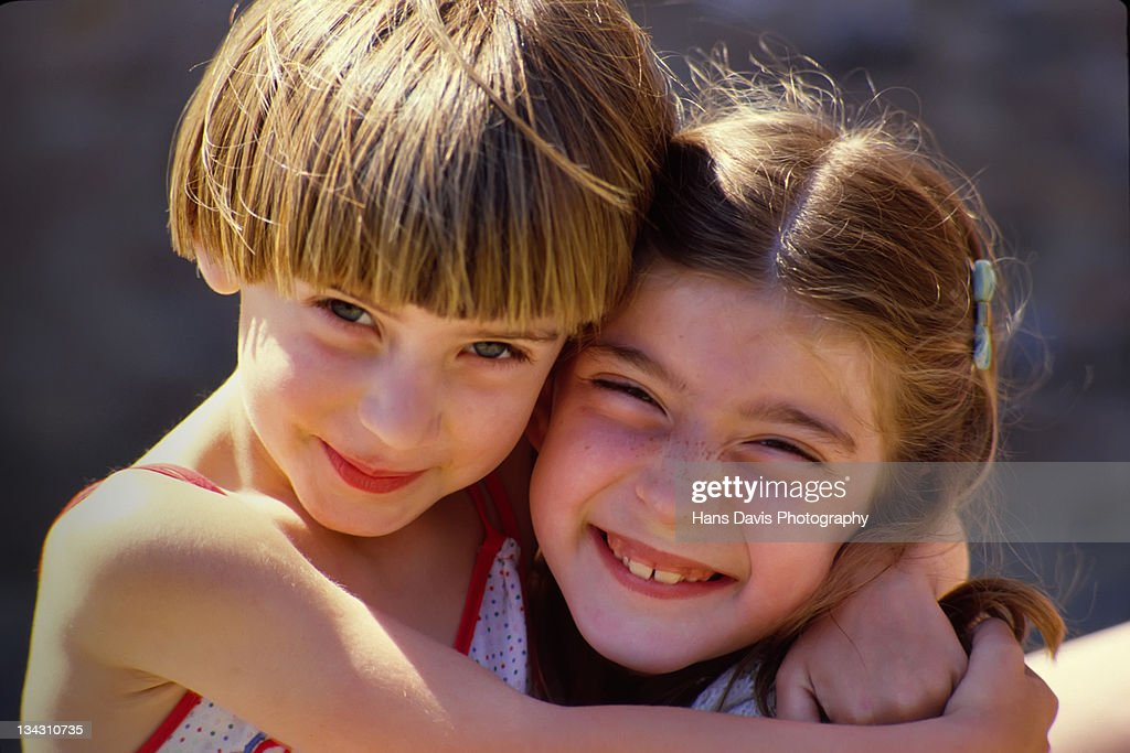 Two young girls smiling at camera : Stock Photo