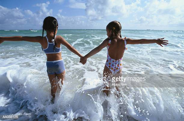 Two Young Girls Wading in the Surf