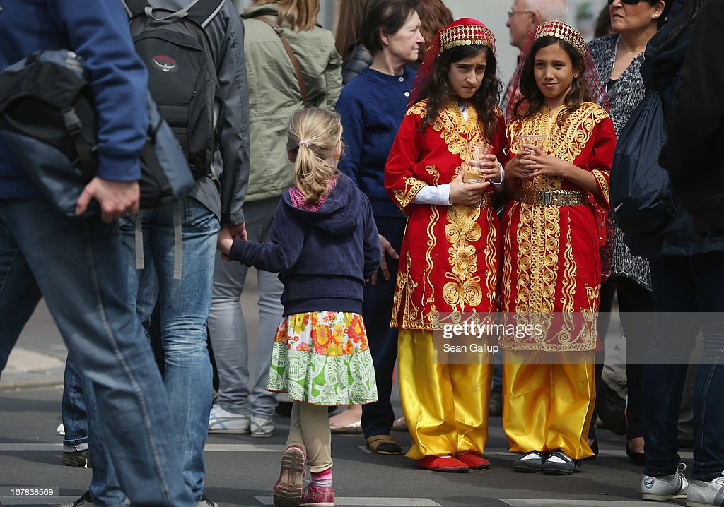 Two young girls wearing traditional Turkish folk outfits attend the MyFest street food and music fest in immigrant-heavy Kreuzberg district on May Day on May 1, 2013 in Berlin, Germany. May Day, the international day of labour, is a national holiday in Germany and observed with gatherings by labour unions and political parties. In some cities, including Hamburg and Berlin, the day often ends with violent clahes between police and mostly left-wing demonstrators.