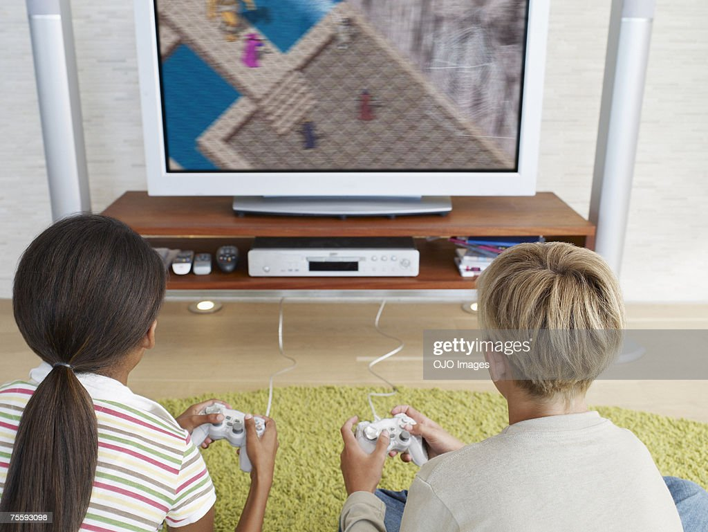 Two young kids playing video games : Stock Photo