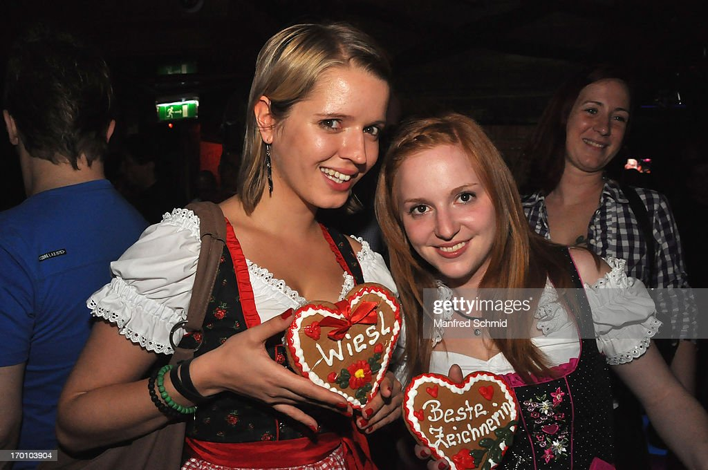 Two young ladies in traditional austrian Dirndl pose during the beauty competition 'Miss Wiener Wiesn-Fest 2013' at Bettel-Alm on June 6, 2013 in Vienna, Austria.