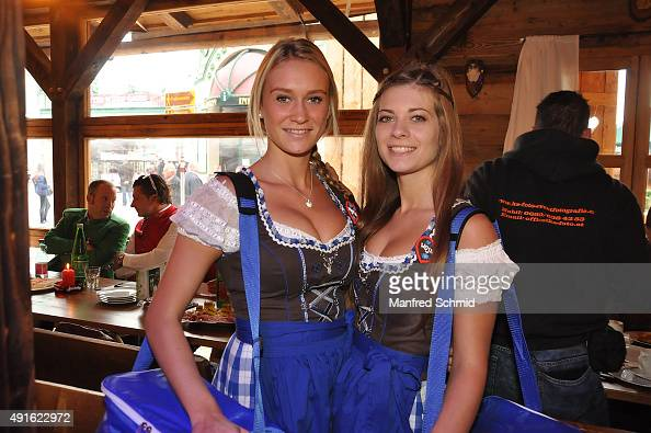 Two young ladies in traditional Austrian Dirndl pose during the Vienna Wiesn 2015 opening on September 24 2015 in Vienna Austria