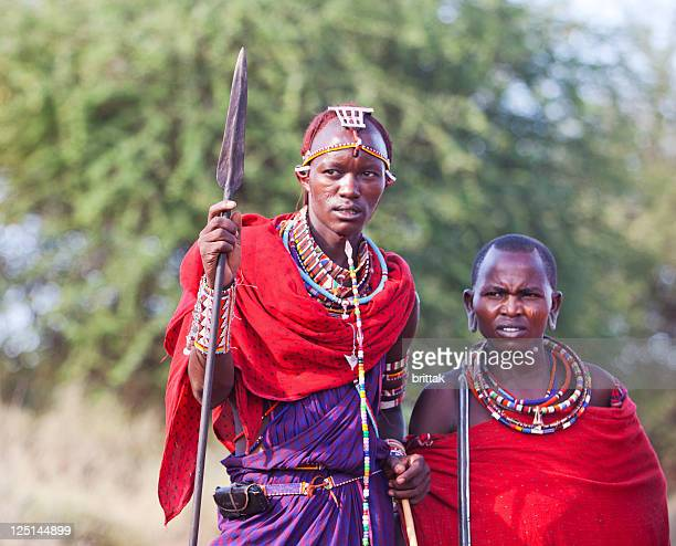 Two young maasai warriors with spears and traditional dress.