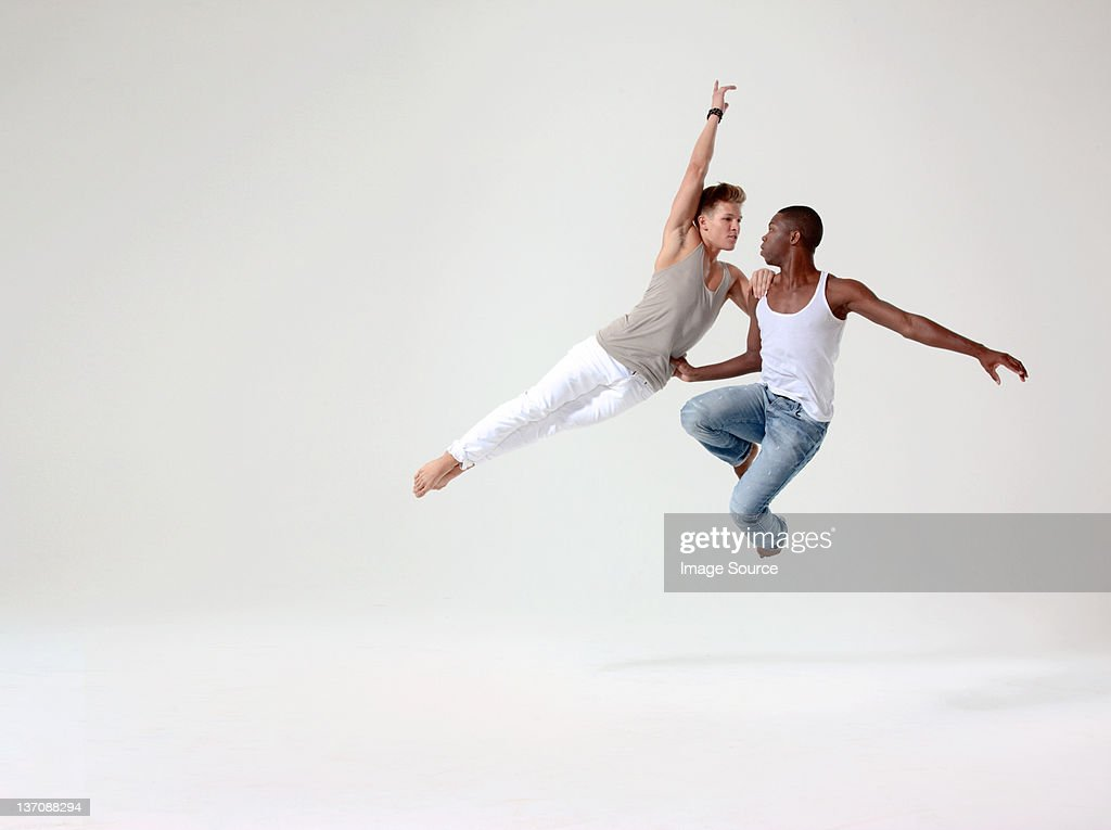 Two young men in mid air