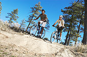 Two Young Men on Mountain Bike Trail