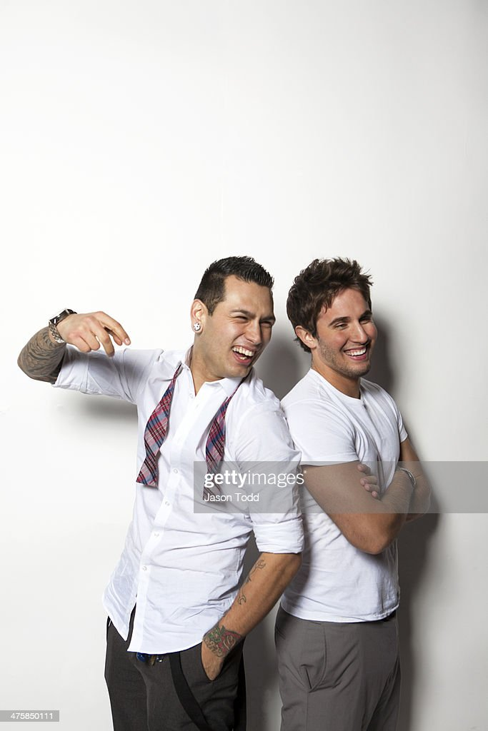 two young men on white in dress attire laughing : Stock Photo