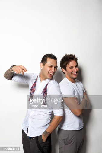 two young men on white in dress attire laughing