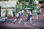 One on one, outdoor basketball. Two players practicing basketball game
