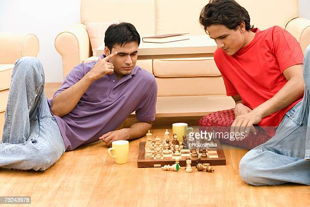 Two young men playing chess