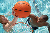 Two Young Men Playing Water Basketball