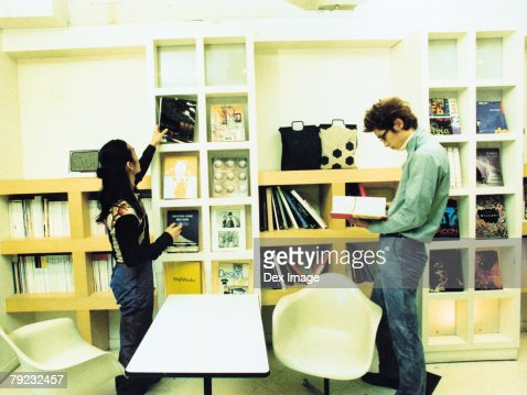 Two young men reading books and magazines : Stock Photo