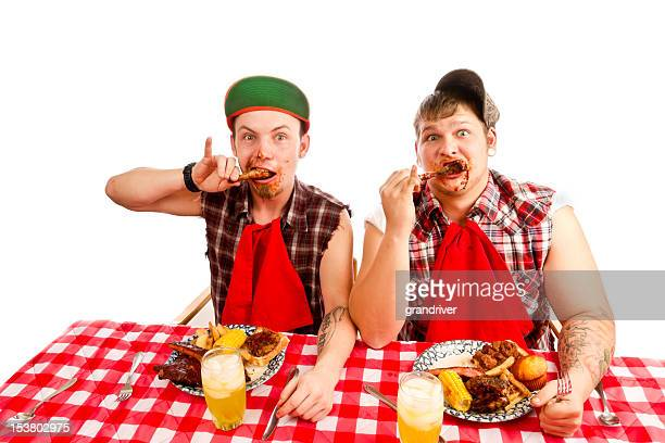 Two Young Men Red Necks Eating Barbeque