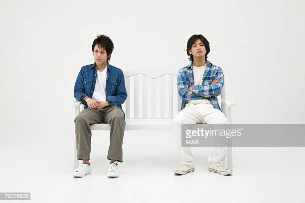 Two young men sitting on bench