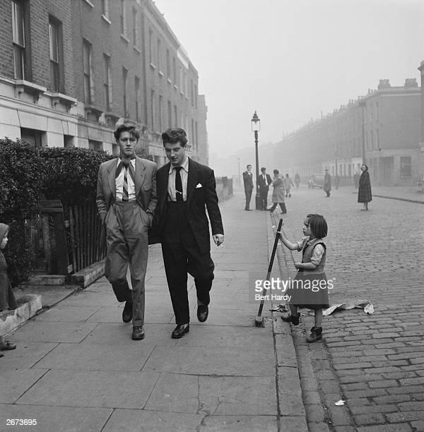 Two young men strolling down a street in London's Notting Hill Original Publication Picture Post 6851 The Best And Worst Of Britain 5 The Young...