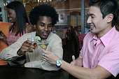 Two young men toasting in a nightclub