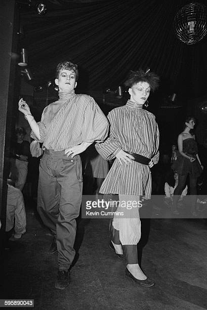 Two young men wearing new romantic fashions at The Hacienda nightclub Manchester 1983