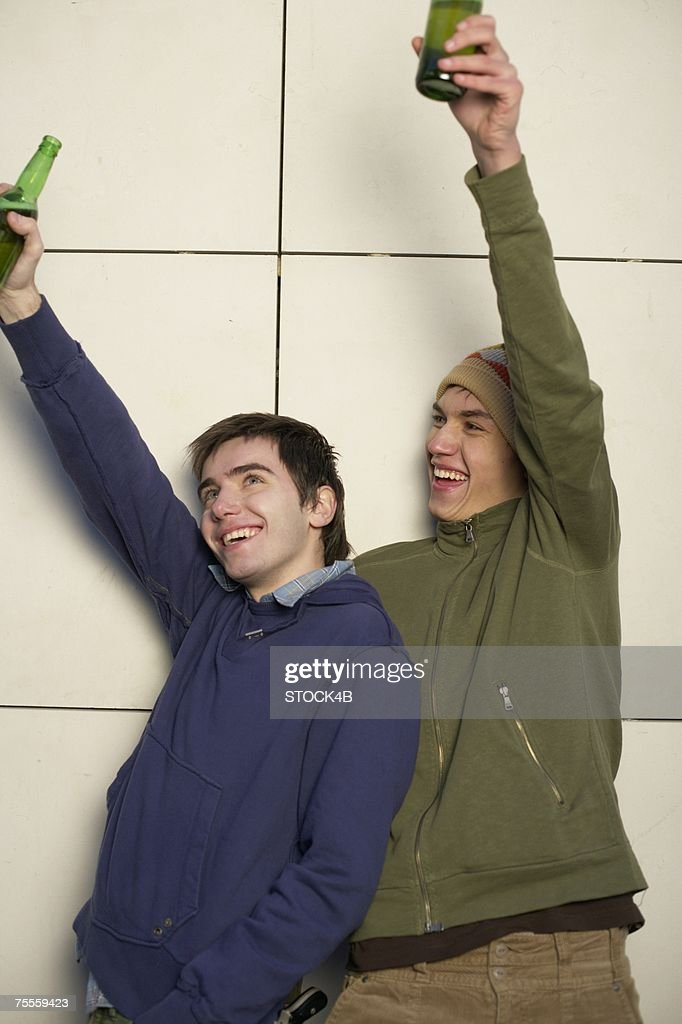 Two young men with bottles of beer : Stock Photo
