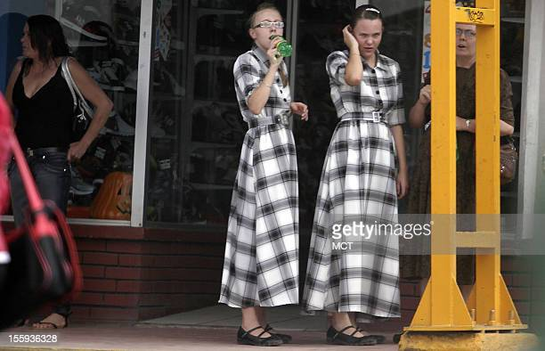 Two young Mennonite women with traditional long dresses are seen in Cuauhtemoc a city in Mexico's Chihuahua state on October 3 2012