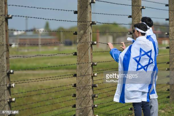 Two young participants look through barbed wire fence during the annual March of the Living inside the former German Nazi Death Camp...