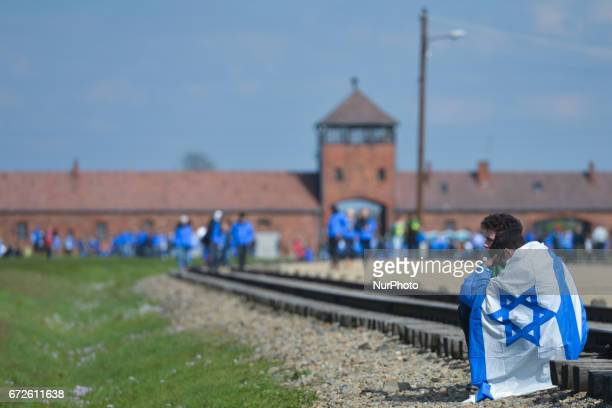 Two young participants meditate during the annual March of the Living inside the former German Nazi Death Camp AuschwitzBirkenau Jewish people from...