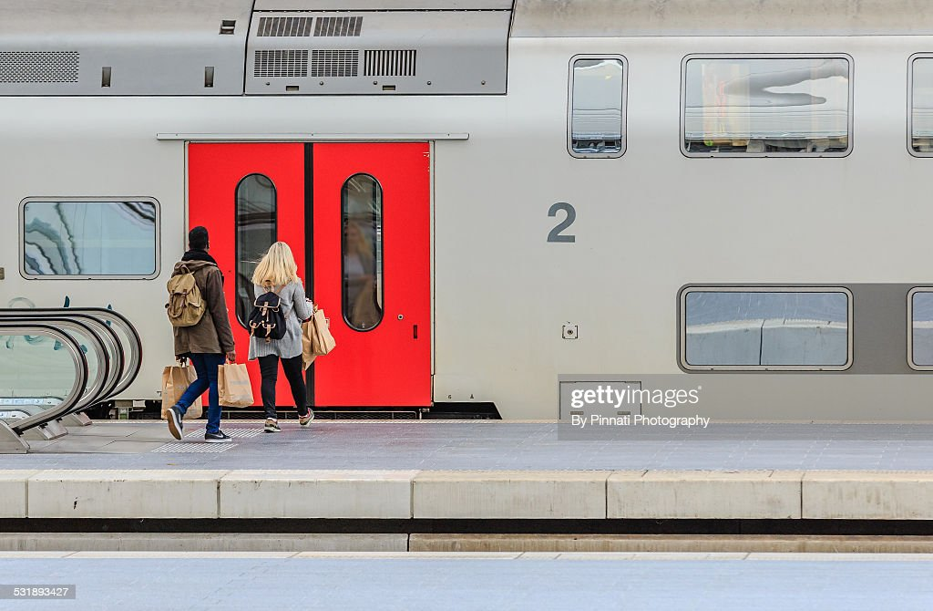 Two young people catching a train