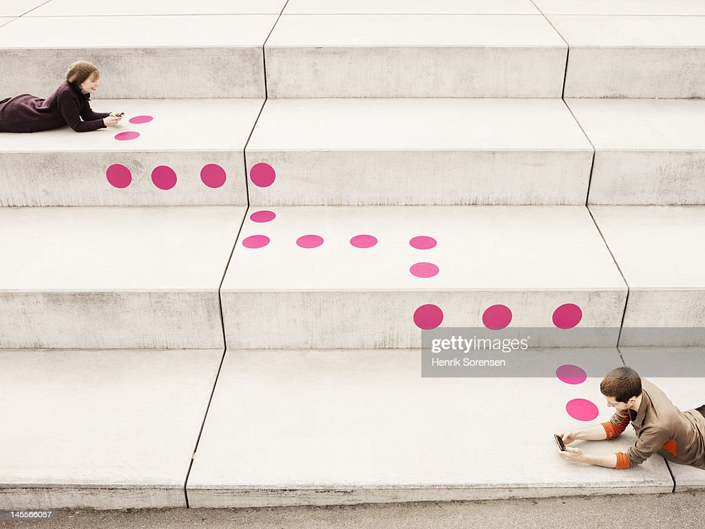 Two Young people connected with dots : Stock Photo