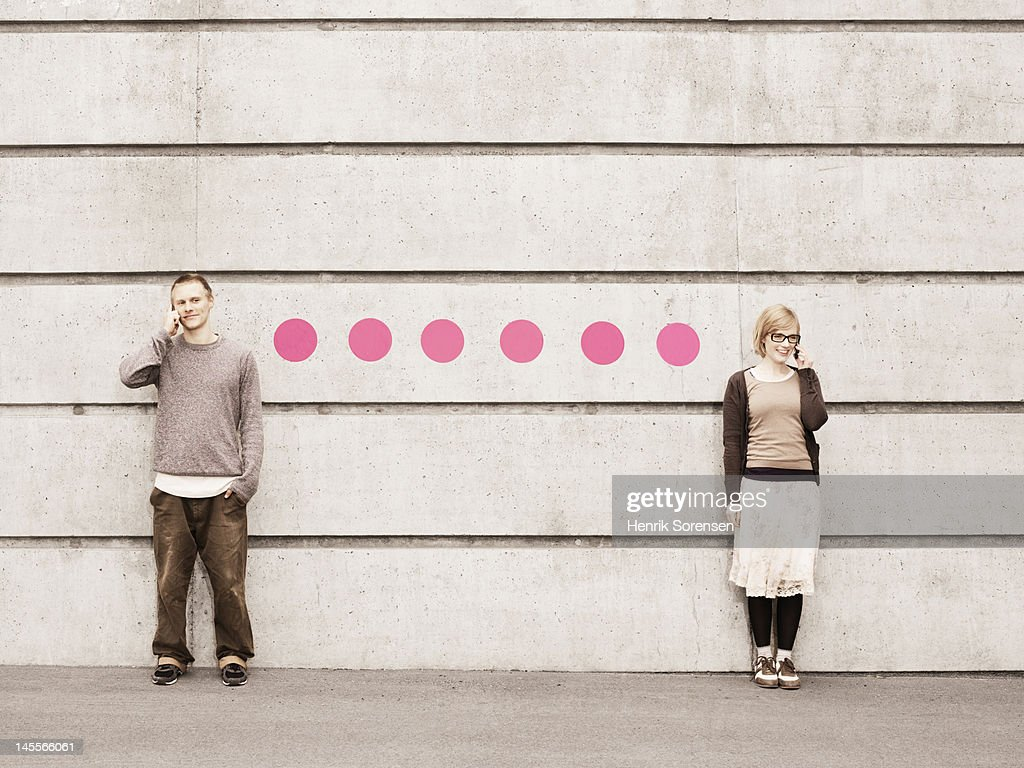 Two young people connected with dots