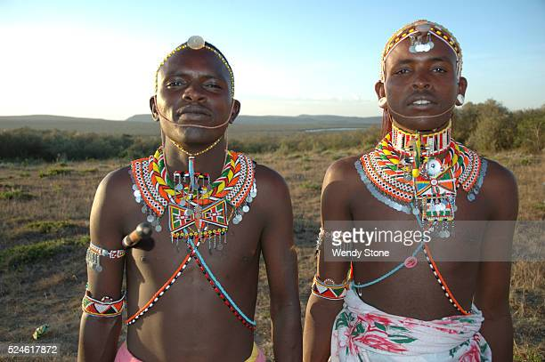 Two young Pokot warriors wearing their elaborate colorful beaded necklaces and headdresses at the Earth Festival at the Laikipia Nature Conservancy...