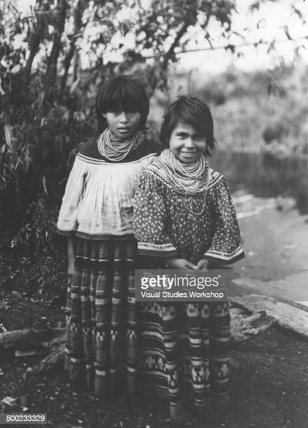 Two young Seminole Indian girls from the Muskhogean tribe originally made up of immigrants from the Lower Creek towns on the Chattahoochee River...
