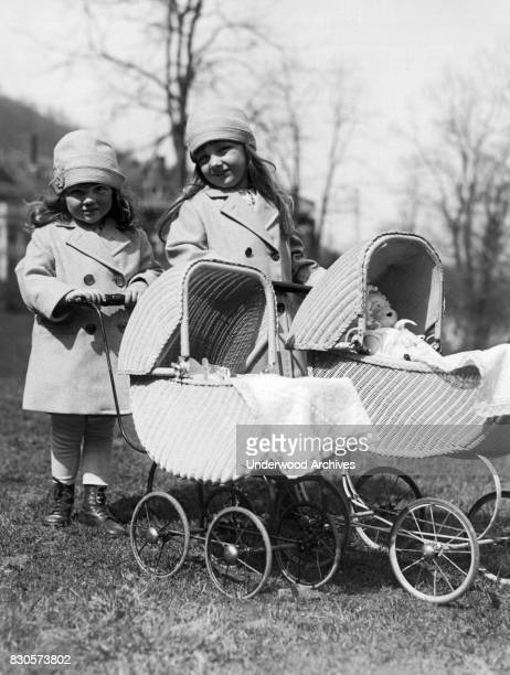 Two young sisters with dolls in their baby carriages Hot Springs Virginia March 21 1927