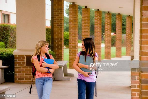 Two young students walking the hall together