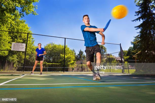 Two Young Teenagers Playing Pickle Ball