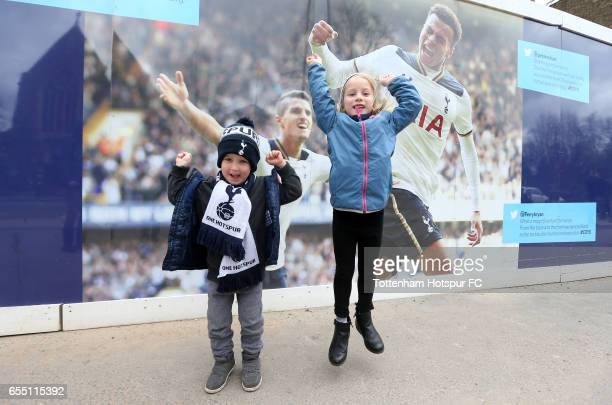 Two young Tottenham Hotspur fans pose outside the stadium prior to the Premier League match between Tottenham Hotspur and Southampton at White Hart...