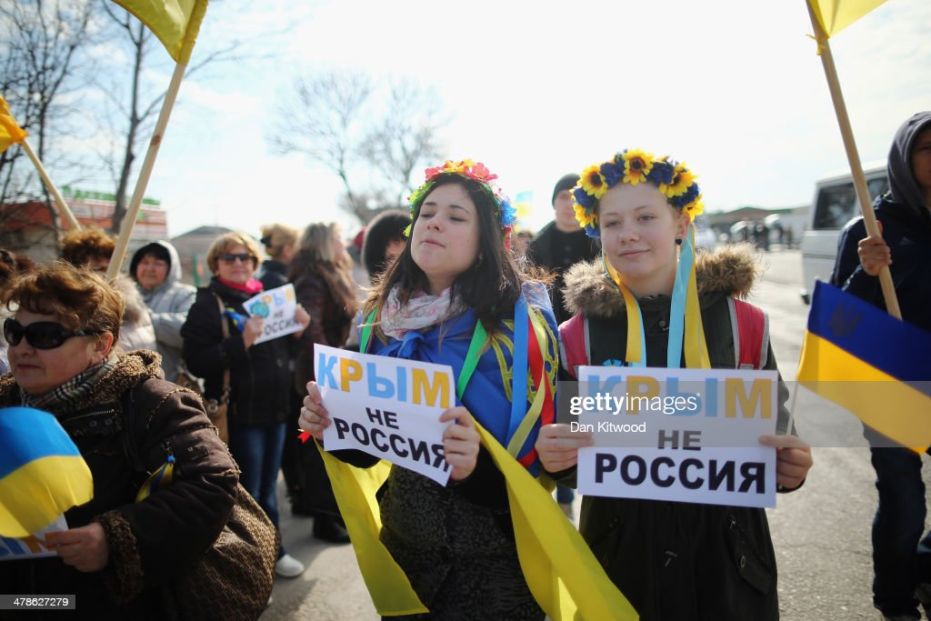 Two young Ukrainian women hold signs that read 'Ukraine not Russia' during a protest against the forthcoming referendum in Crimea on March 14, 2014 in Simferopol, Ukraine. As the standoff between the Russian military and Ukrainian forces continues in Ukraine's Crimean peninsula, world leaders are pushing for a diplomatic solution to the escalating situation. Crimean citizens will vote in a referendum on 16 March on whether to become part of the Russian federation.