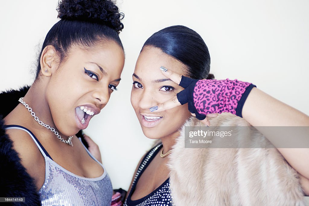 two young urban women wearing party clothes : Stock Photo