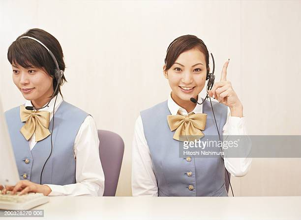 Two young wearing headset, smiling