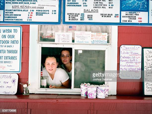 Two Young Women at a Concession Stand