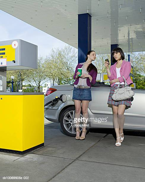 Two young women at petrol station